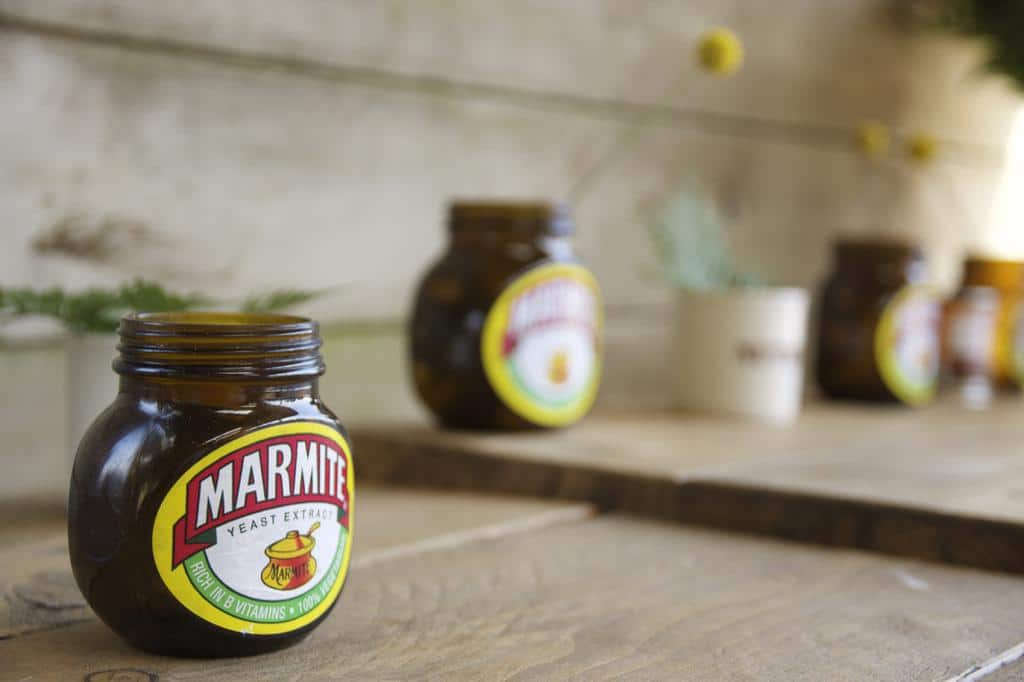 Marmite jars as flower vases at wedding