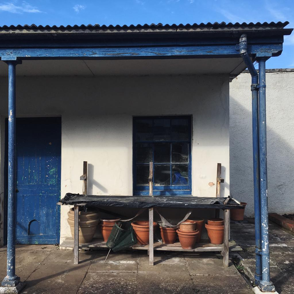 Blue painted potting shed
