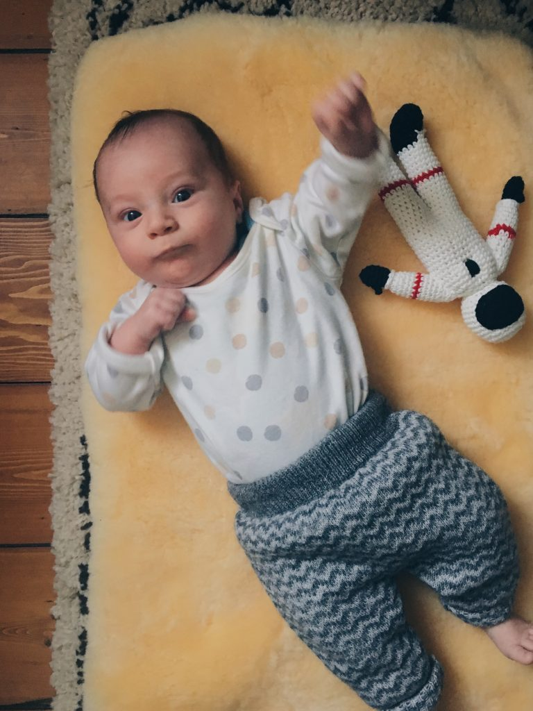 52 project one month baby on sheepskin rug