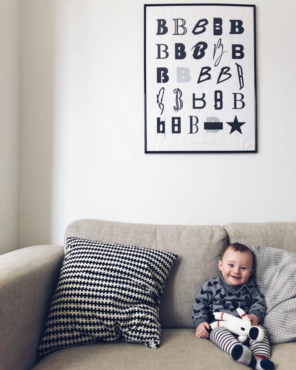 baby sat on sofa at 5 months