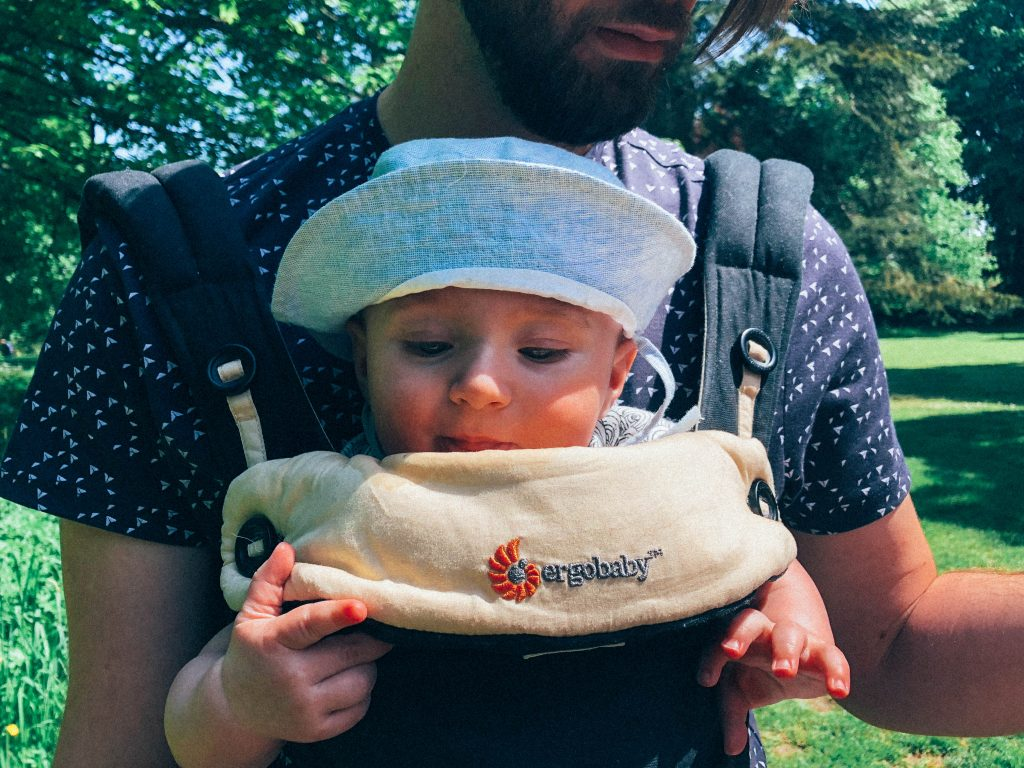 baby in Ergo carrier in the park at 5 months